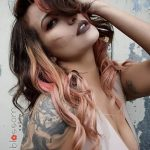 vivid peach brunette hair